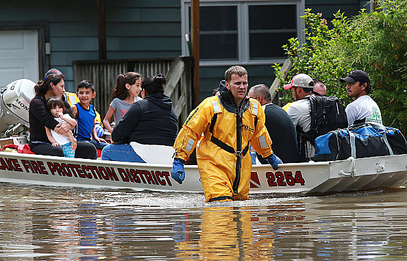 Downpours flood Chicago-area streets, basements -- with more rain on way