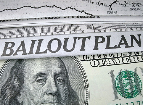 "Newspaper headline ""Bailout Plan"" and currency"